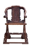 A HUANGHUALI CARVED FOLDING CHAIR