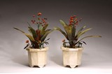 A PAIR OF GREEN JADE AND AMBER 'ORCHIDS' MARBLE PLANTERS