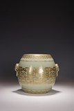 A CHINESE CELADON AND GILT DRUM SHAPED JAR
