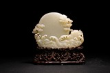 A CHINESE WHITE JADE CARVING OF 'RISING SUN'
