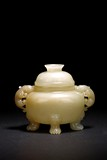 A CHINESE WHITE JADE CARVED TRIPOD CENSER