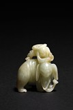 A CELADON JADE CARVING OF ELEPHANT AND BOY