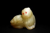 A CELADON JADE CARVING OF MYTHICAL BEAST
