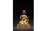 A GILT BRONZE FIGURE OF TIBETAN GURU