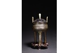 A BRONZE TRIPOD CENSER WITH HARDWOOD COVER & STAND