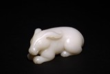 A CHINESE WHITE NEPHRITE JADE CARVED RABBIT
